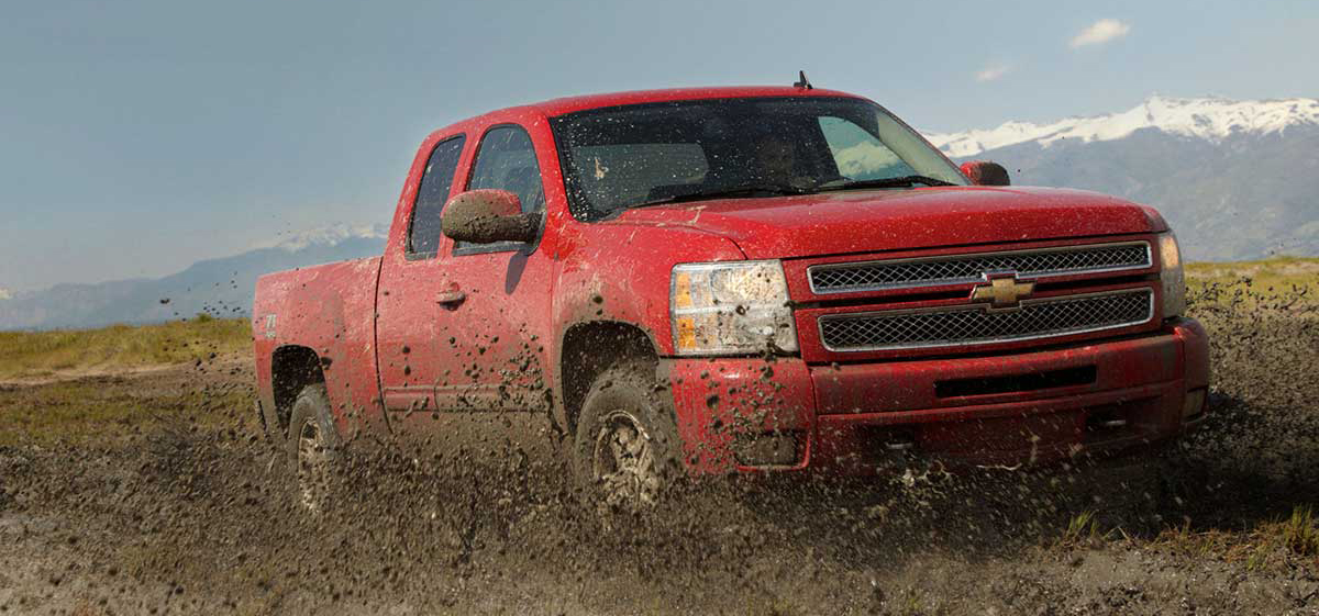 Red Chevy Truck in Mud