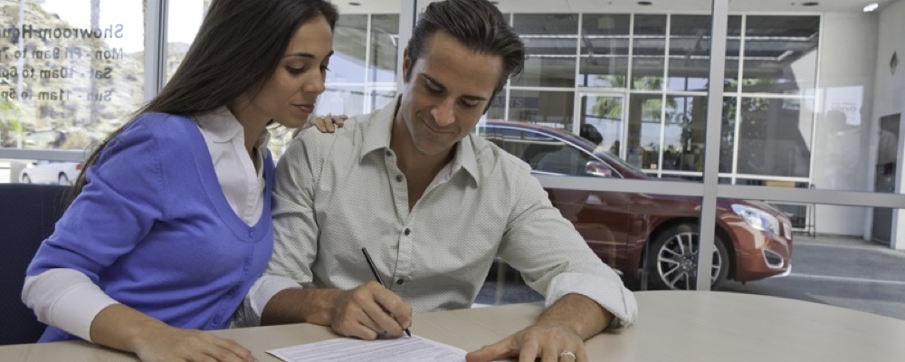 Man and woman signing papers
