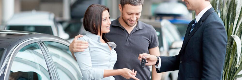 man and woman getting keys