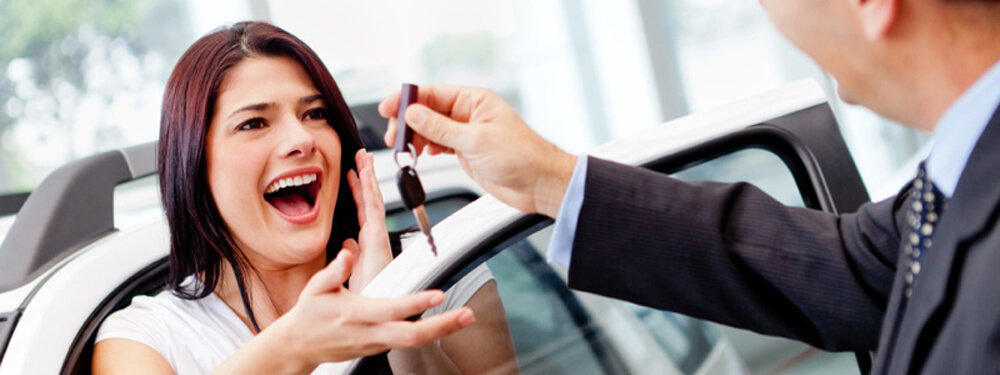 woman excitedly gets car keys