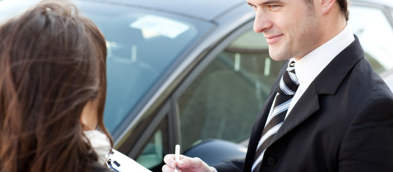 Confident businessman undersign a car contract
