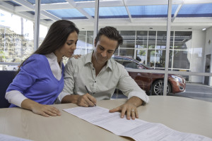 Man and woman signing financing papers