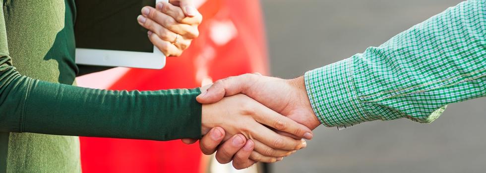 Handshake between dealership and buyer