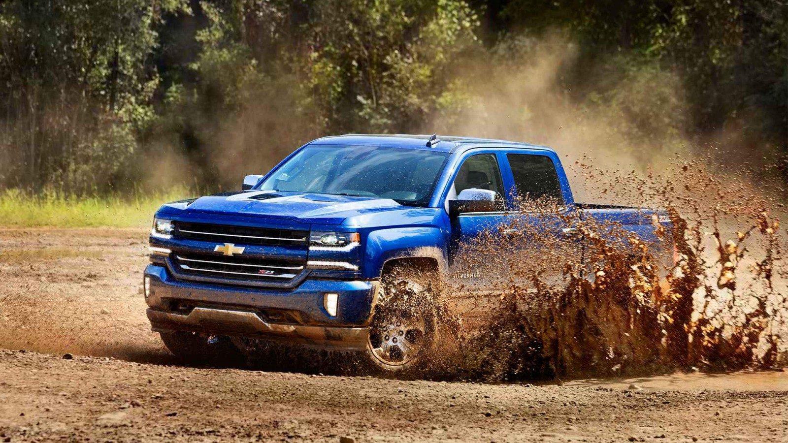 Blue 2016 Chevrolet Silverado 1500 in action