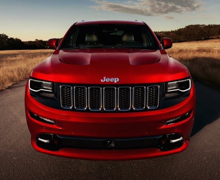 Lowering The Ride Height And Adding Larger Wheels And Tires Along With Fire  Red Brake Callipers, The 2013 Grand Cherokee Is Nothing If Not Tough.