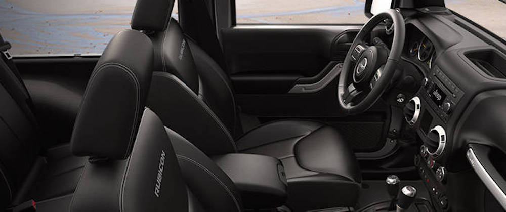 The black interior is shown in a used Jeep Wrangler Rubicon.